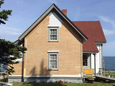 The keeper's house was prepped, primed and repainted (and rotted wood repaired) during late 2014.  (FLRL photo)